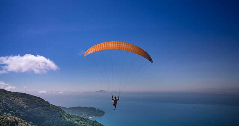 Paragliding Over the Ocean